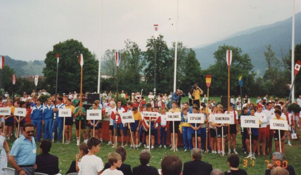 Young rowers lining up with country placards
