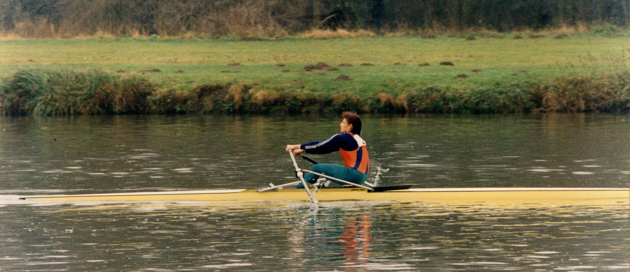 woman in Empacher single scull