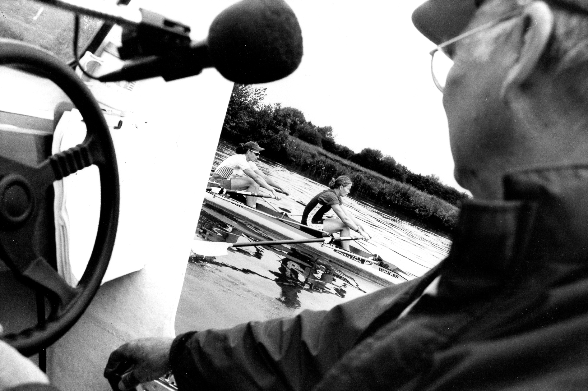 coach in launch and women's double scull b/w photo