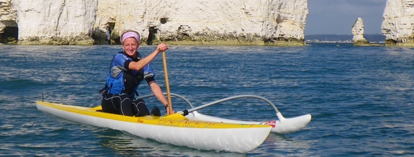 Trisha in an OC1 off Old Harry Rocks, Dorset