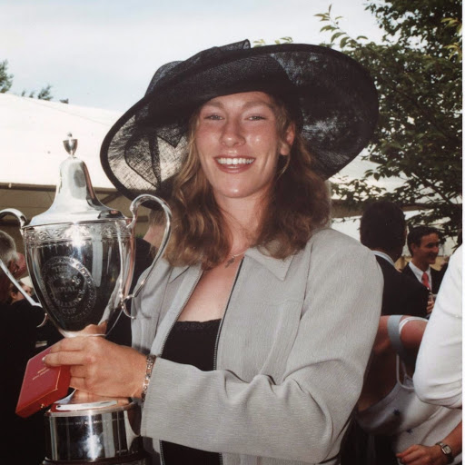 Woman in large hat with silver cup