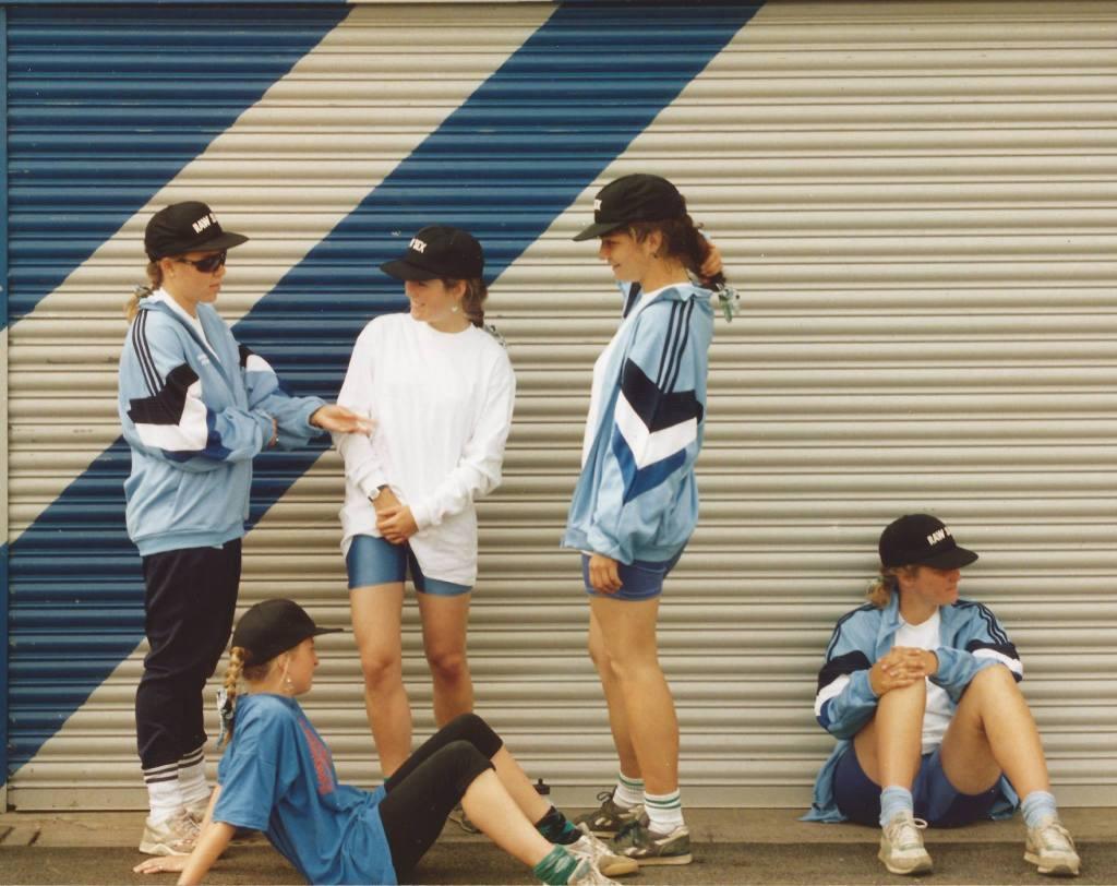 4 women in pale blue tracksuit tops