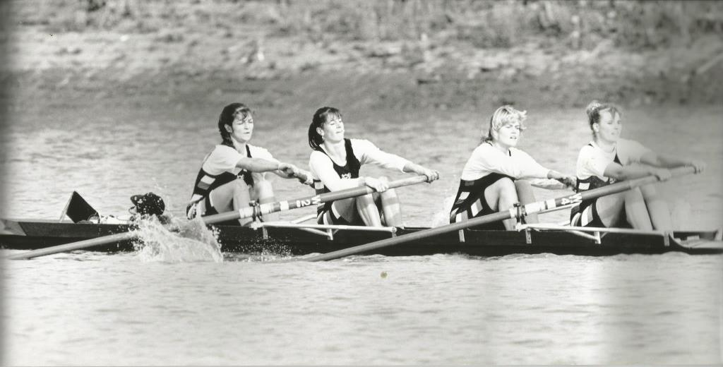 b/w photo of women's coxed four