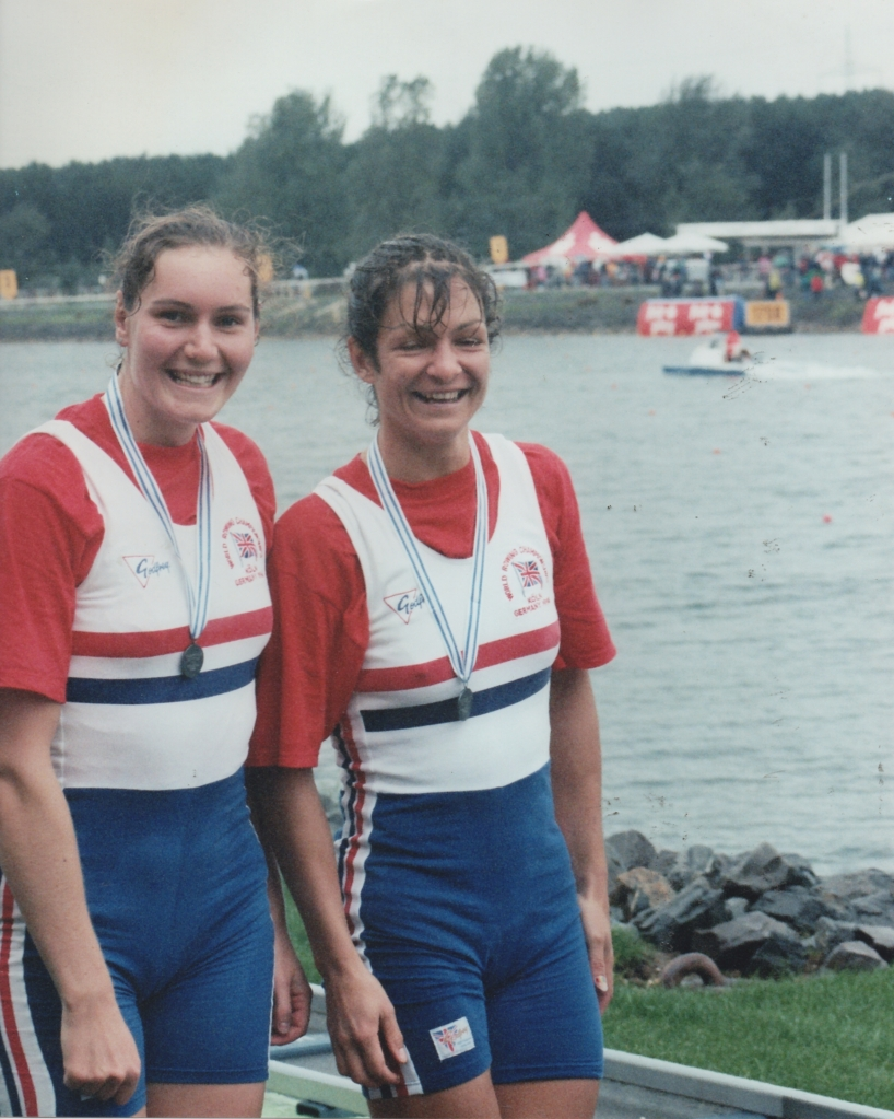Two women wearing silver medals