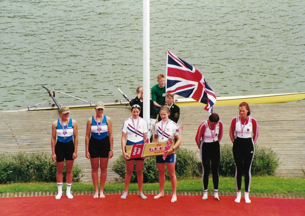 6 women with medals - 2 GBR  women in centre with Union Jack behind