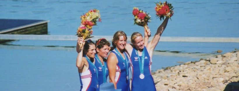 4 women at Sydney Olympics with silver medals and bouquets