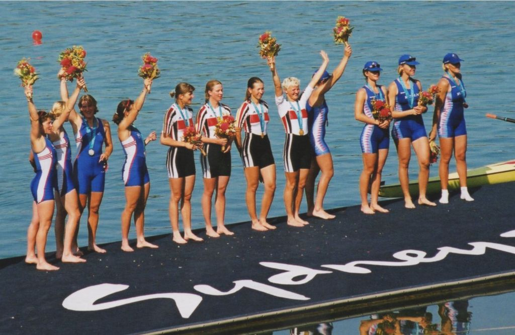 12 women with medals on presentation raft
