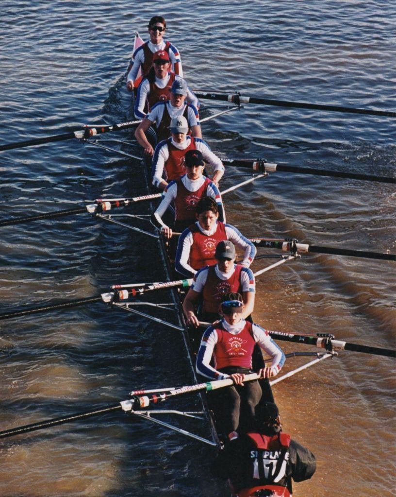 Women's eight in dark red kit