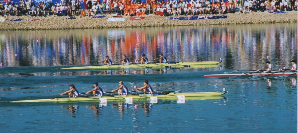 Three women's quads women's approach the line in the 2000 Olympic final